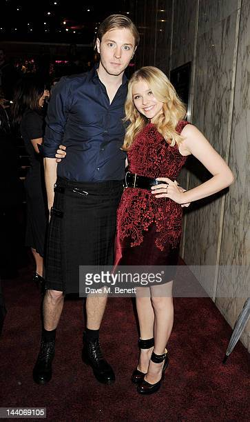 Actress Chloe Moretz and brother attend the European Premiere of 'Dark Shadows' at Empire Leicester Square on May 9 2012 in London England