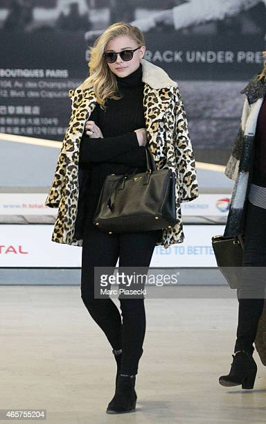 Actress Chloe Moretz arrives at CharlesdeGaulle airport during the Paris Fashion Week Fall Winter 2015/2016 on March 10 2015 in Paris France