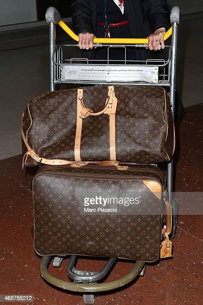 louis vuitton luggage. actress chloe moretz louis vuitton luggage detail arrives at charlesdegaulle airport during the paris fashion week