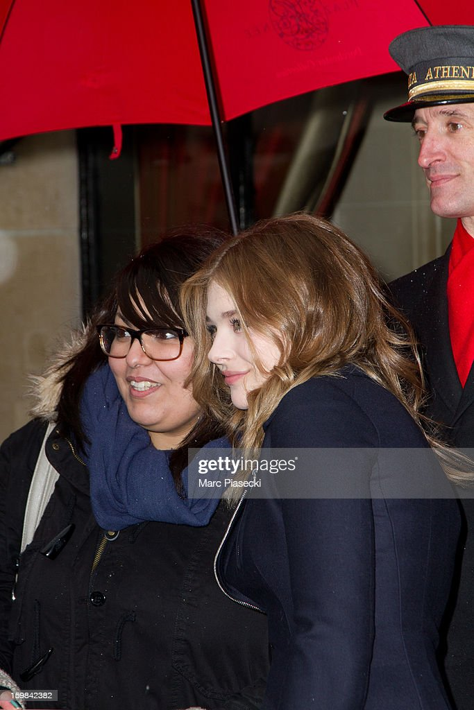 Actress Chloe Moretz poses with french fan as she is seen leaving the 'Plaza Athenee' hotel on January 21, 2013 in Paris, France.