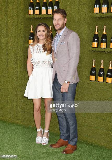 Actress Chrishell Stause and actor Justin Hartley attend the 8th Annual Veuve Clicquot Polo Classic at Will Rogers State Historic Park on October 14...