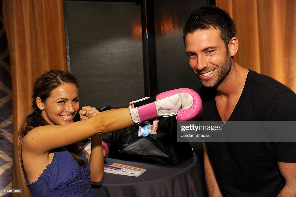 Actress Chrishell Stause and actor Ricky Paull Goldin pose in the Daytime Emmy official gift lounge produced by On 3 Productions held at The Orpheum Theatre on August 29, 2009 in Los Angeles, California.