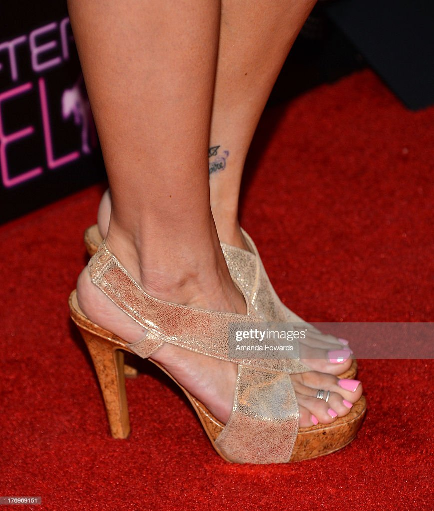 Actress Chrishell Stause (shoe detail) arrives at the Los Angeles premiere of 'Afternoon Delight' at ArcLight Hollywood on August 19, 2013 in Hollywood, California.