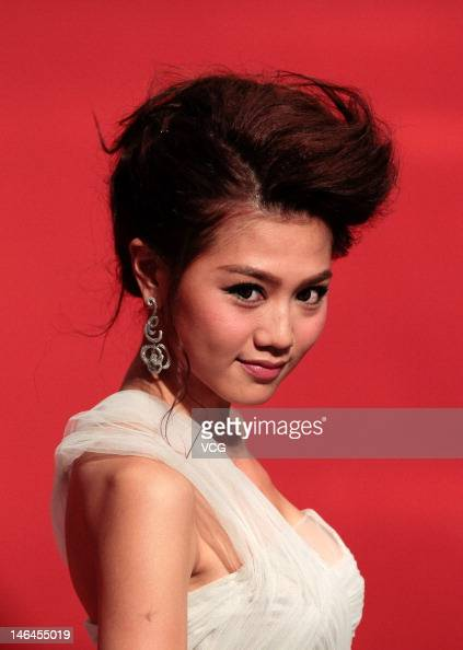 Actress Chrissie Chau arrives at the red carpet during the opening ceremony for the 15th Shanghai International Film Festival at Shanghai Grand...