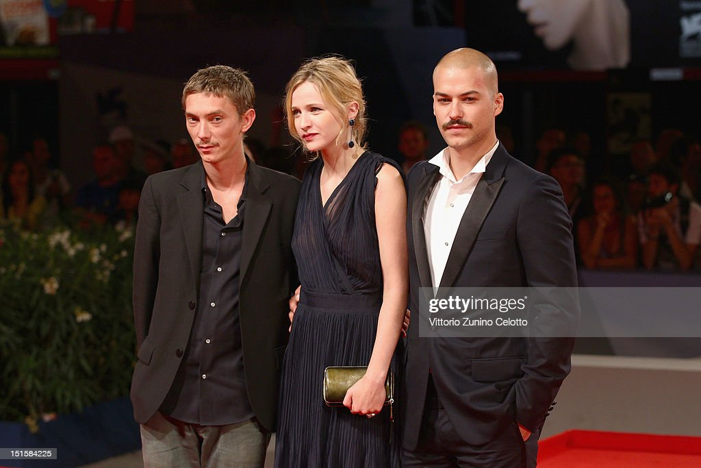 Actress Christa Theret (C) and actor Marc-Andre Grondin (R) attend the 'L'Homme Qui Rit' Premiere during the 69th Venice Film Festival at the Palazzo del Cinema on September 8, 2012 in Venice, Italy.