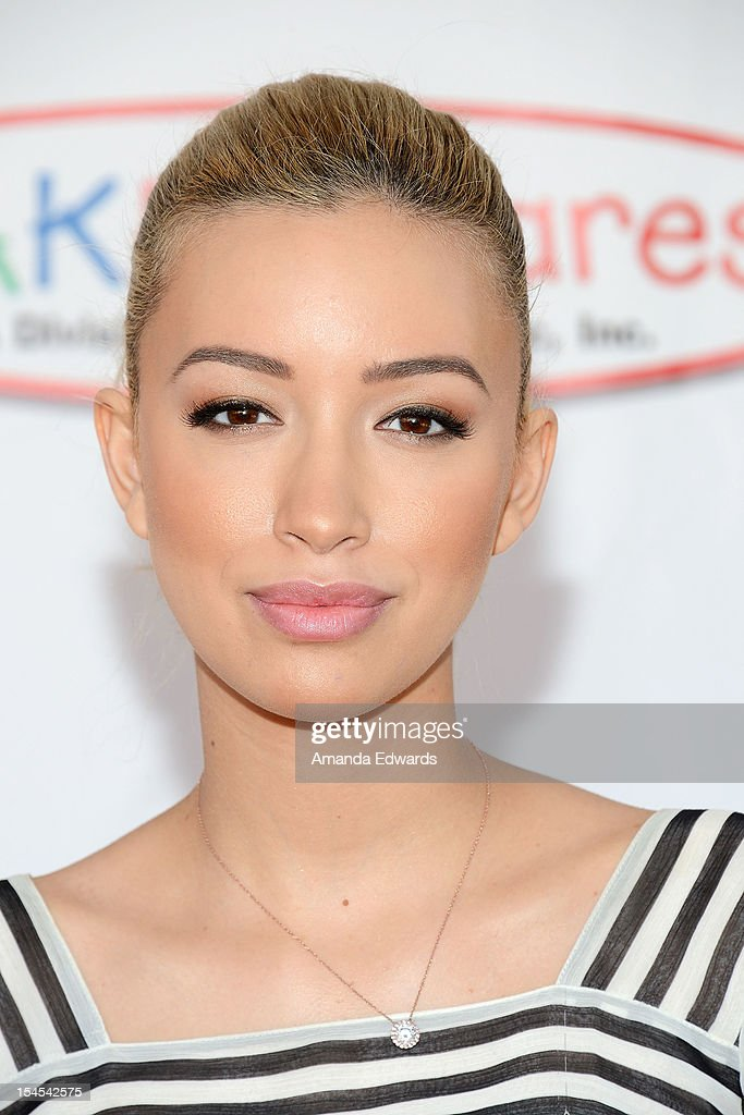 Actress Christian Serratos arrives at the Camp Ronald McDonald For Good Times 20th Annual Halloween Carnival at Universal Studios Backlot on October 21, 2012 in Universal City, California.