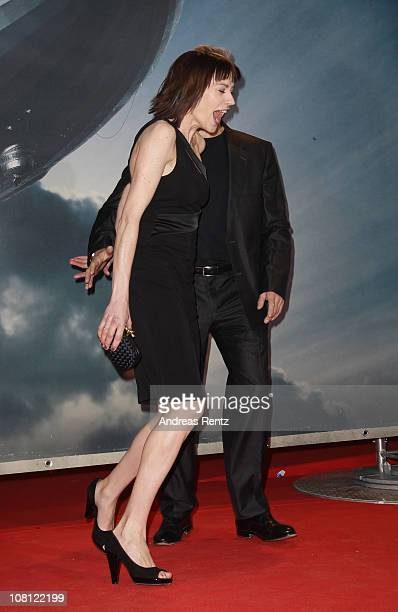 Actress Christiane Paul and actor Hannes Jaenicke arrive for the Hindenburg premiere at Kosmos theater on January 18 2011 in Berlin Germany