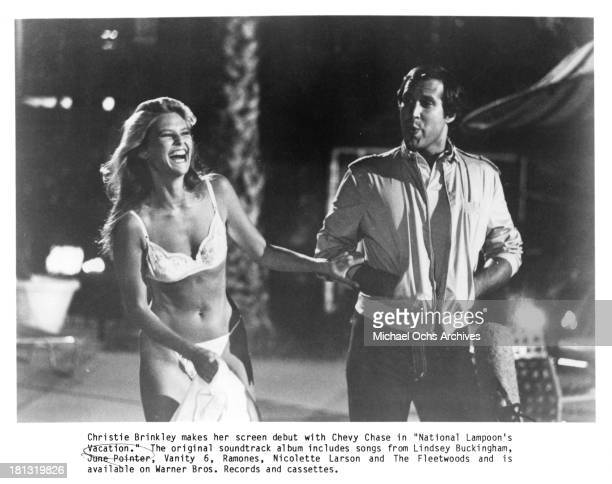 Actress Christie Brinkley and actor Chevy Chase on the set of Warner Bros movie 'National Lampoon's Vacation' in 1983