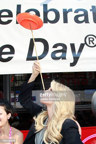 Actress Christie Brinkley demonstrates plate balancing at 2012 World Smile Day in Times Square on October 5 2012 in New York City