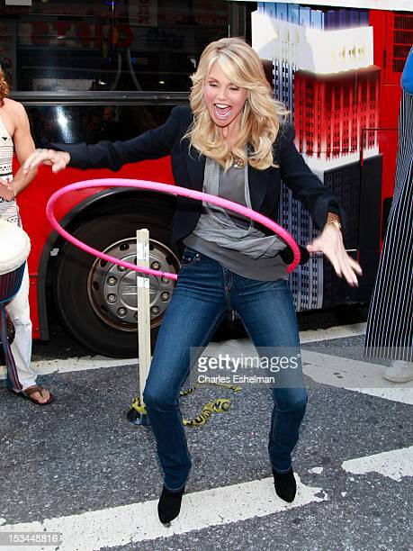 Actress Christie Brinkley hula hoops at the 2012 World Smile Day in Times Square on October 5 2012 in New York City