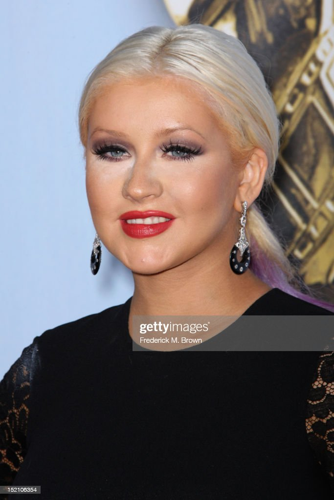 Actress <a gi-track='captionPersonalityLinkClicked' href=/galleries/search?phrase=Christina+Aguilera&family=editorial&specificpeople=171272 ng-click='$event.stopPropagation()'>Christina Aguilera</a> arrives at the 2012 NCLR ALMA Awards at Pasadena Civic Auditorium on September 16, 2012 in Pasadena, California.