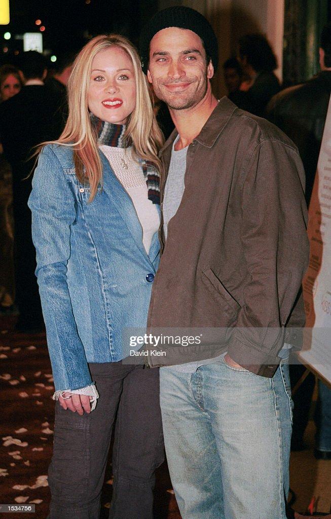 Actress Christina Applegate actor Johnathon Schaech arrive at the premiere of 'Kiss the Bride' at the Showcase Regent Theatre October 23, 2002 in Los Angeles, California.