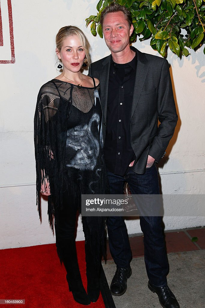 Actress <a gi-track='captionPersonalityLinkClicked' href=/galleries/search?phrase=Christina+Applegate&family=editorial&specificpeople=171273 ng-click='$event.stopPropagation()'>Christina Applegate</a> (L) and bassist Martyn LeNoble of Porno for Pyros attend the premiere of 'Kumpania Flamenco Los Angeles' at El Cid on January 31, 2013 in Los Angeles, California.