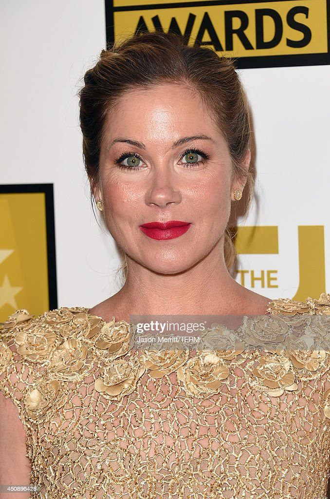 Actress Christina Applegate (jewelry detail) poses in the press room during the 4th Annual Critics' Choice Television Awards at The Beverly Hilton Hotel on June 19, 2014 in Beverly Hills, California.
