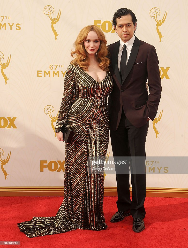 Actress Christina Hendricks and husband Geoffrey Arend arrive at the 67th Annual Primetime Emmy Awards at Microsoft Theater on September 20, 2015 in Los Angeles, California.