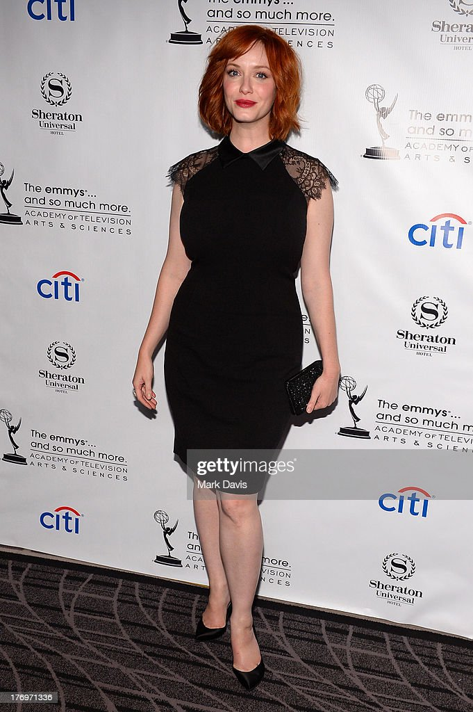 Actress <a gi-track='captionPersonalityLinkClicked' href=/galleries/search?phrase=Christina+Hendricks&family=editorial&specificpeople=2239736 ng-click='$event.stopPropagation()'>Christina Hendricks</a> arrives at the Academy of Television Arts & Sciences' Performers Peer Group cocktail reception to celebrate the 65th Primetime Emmy Awards at Sheraton Universal on August 19, 2013 in Universal City, California.