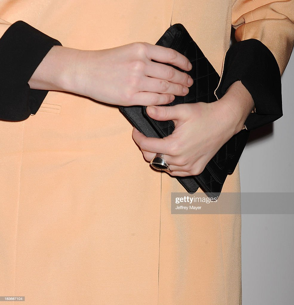 Actress <a gi-track='captionPersonalityLinkClicked' href=/galleries/search?phrase=Christina+Hendricks&family=editorial&specificpeople=2239736 ng-click='$event.stopPropagation()'>Christina Hendricks</a> (handbag, ring detail) at the Tacori's Annual Club Tacori 2013 Event at Greystone Manor Supperclub on October 8, 2013 in West Hollywood,