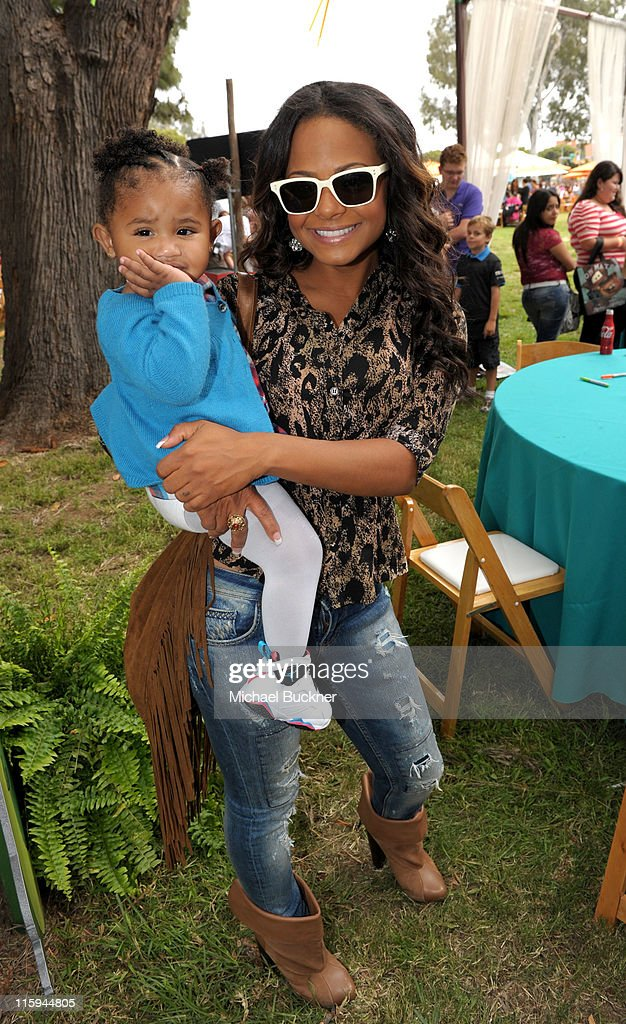 Actress <a gi-track='captionPersonalityLinkClicked' href=/galleries/search?phrase=Christina+Milian&family=editorial&specificpeople=171274 ng-click='$event.stopPropagation()'>Christina Milian</a> (L) and daughter Violet Madison Nash attend the 22nd Annual Time for Heroes Celebrity Picnic sponsored by Disney to benefit the Elizabeth Glaser Pediatric AIDS Foundation at Wadsworth Theater on the Veteran Administration Lawn on June 12, 2011 in Los Angeles, California.