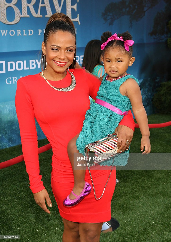 Actress Christina Milian (L) and daughter Violet Nash arrive at Film Independent's 2012 Los Angeles Film Festival Premiere of Disney Pixar's 'Brave' at Dolby Theatre on June 18, 2012 in Hollywood, California.