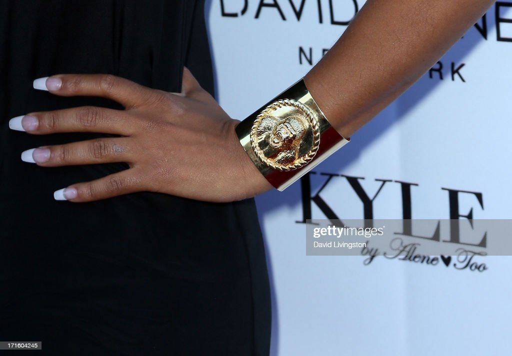 Actress Christina Milian (bracelet detail) attends a fashion fundraiser benefitting Children's Hospital of Los Angeles hosted by Kyle Richards at Kyle by Alene Too on June 26, 2013 in Beverly Hills, California.