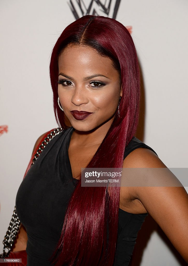 Actress <a gi-track='captionPersonalityLinkClicked' href=/galleries/search?phrase=Christina+Milian&family=editorial&specificpeople=171274 ng-click='$event.stopPropagation()'>Christina Milian</a> attends WWE & E! Entertainment's 'SuperStars For Hope' at the Beverly Hills Hotel on August 15, 2013 in Beverly Hills, California.