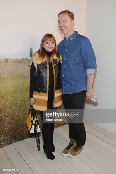 Actress Christina Ricci and designer Stuart Vevers pose backstage at the Coach Women's Spring 2016 fashion show during New York Fashion Week at The...