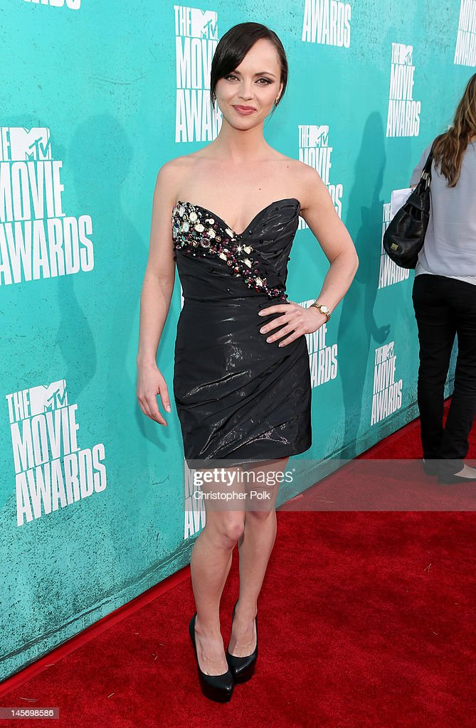 Actress <a gi-track='captionPersonalityLinkClicked' href=/galleries/search?phrase=Christina+Ricci&family=editorial&specificpeople=239510 ng-click='$event.stopPropagation()'>Christina Ricci</a> arrives at the 2012 MTV Movie Awards held at Gibson Amphitheatre on June 3, 2012 in Universal City, California.