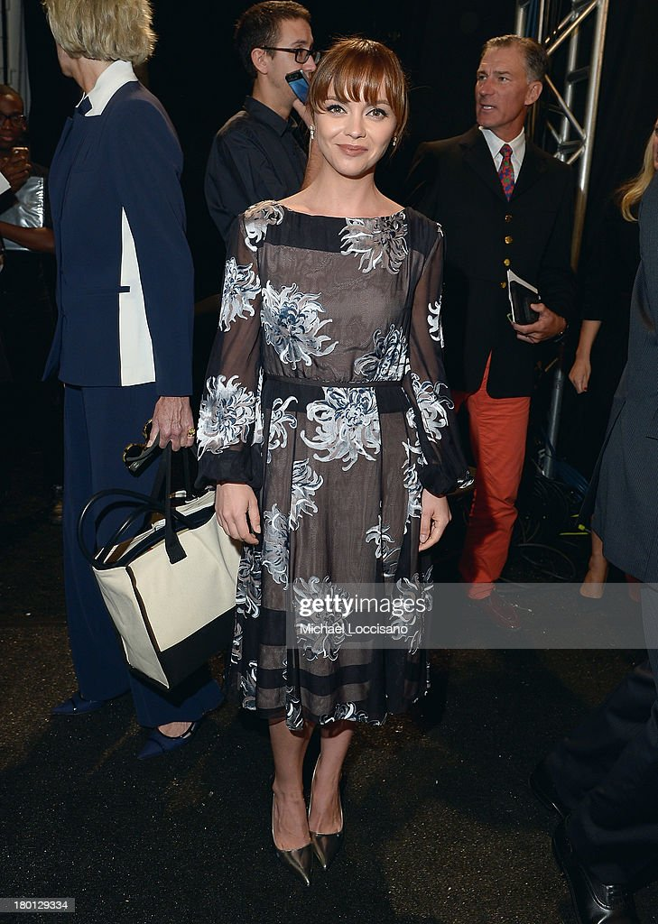 Actress <a gi-track='captionPersonalityLinkClicked' href=/galleries/search?phrase=Christina+Ricci&family=editorial&specificpeople=239510 ng-click='$event.stopPropagation()'>Christina Ricci</a> poses backstage at the Carolina Herrera fashion show during Mercedes-Benz Fashion Week Spring 2014 at The Theatre at Lincoln Center on September 9, 2013 in New York City.
