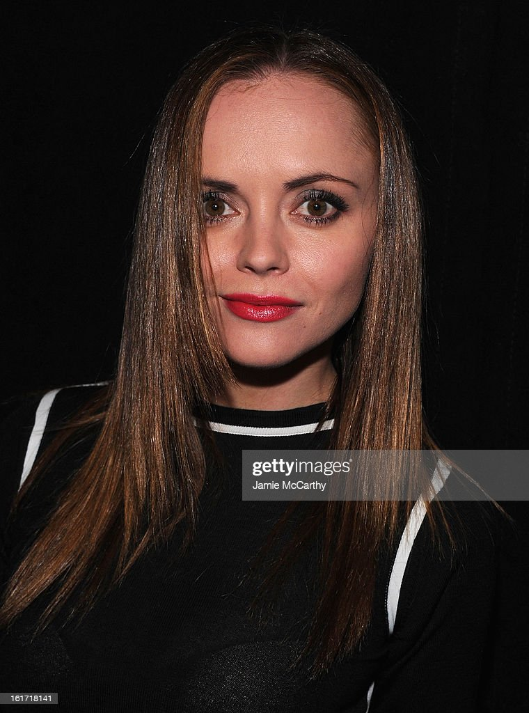 Actress Christina Ricci poses backstage at the Marc Jacobs Collection Fall 2013 fashion show during Mercedes-Benz Fashion Week at New York Armory on February 14, 2013 in New York City.