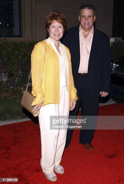Actress Christine Estabrook and husband Vic Polizos attend the Desperate Housewives Premiere Party on October 3 2004 at Barney's in Beverly Hills CA