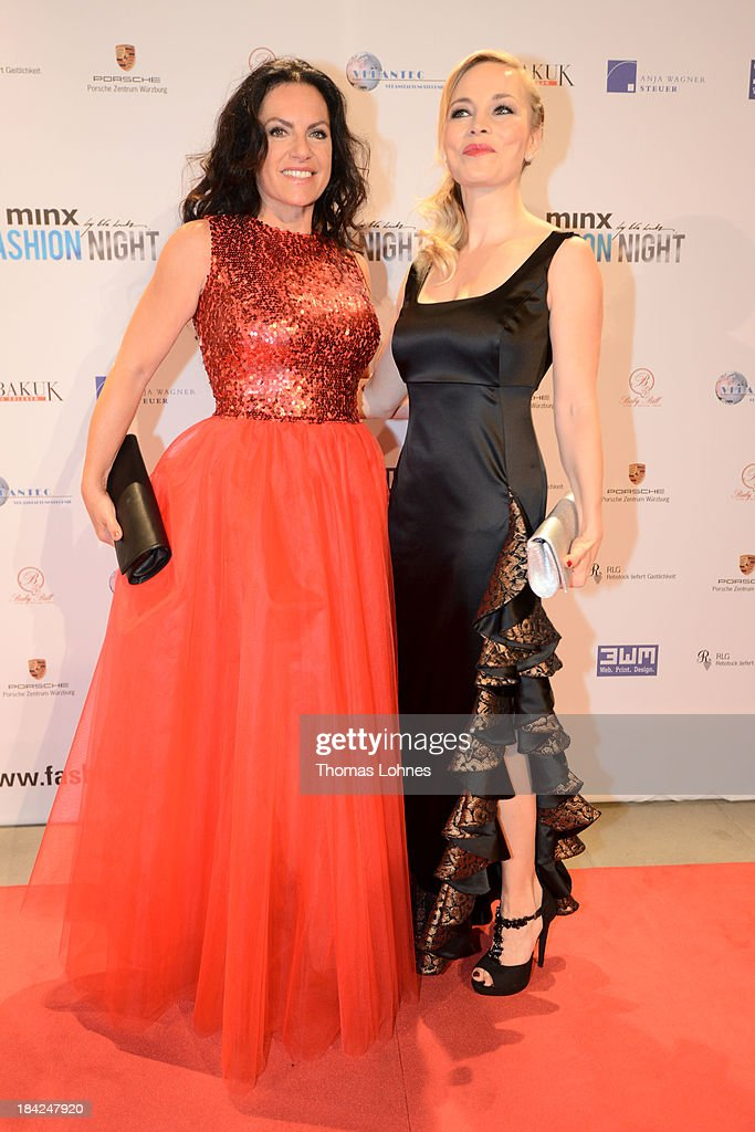 Actress Christine Neubauer (l) and Regina Halmich (r) pose at the piano during the Minx fashion night at Residenz on October 12, 2013 in Wuerzburg, Germany. The benefit of the charity gala is for the aid organisation 'Sauti Kuu' of Auma Obama. Behind the fashion label Minx stands Eva Lutz.