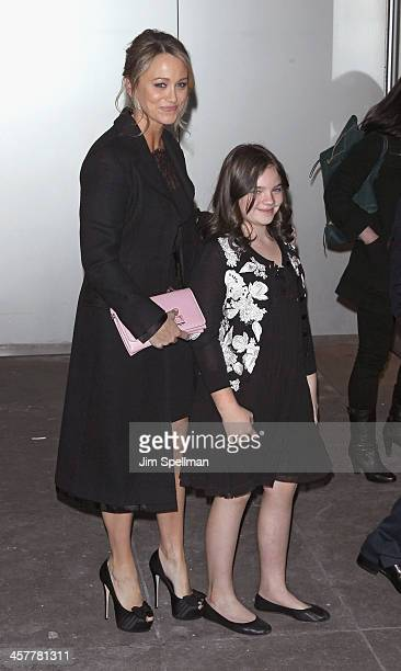Actress Christine Taylor and daughter Ella Olivia Stiller attend the 20th Century Fox With The Cinema Society Brooks Brothers screening of 'The...