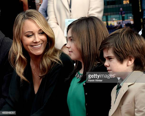 Actress Christine Taylor and her children Ella Stiller and Quinlin Stiller watch as actor Ben Stiller is honored with a hand and footprint ceremony...