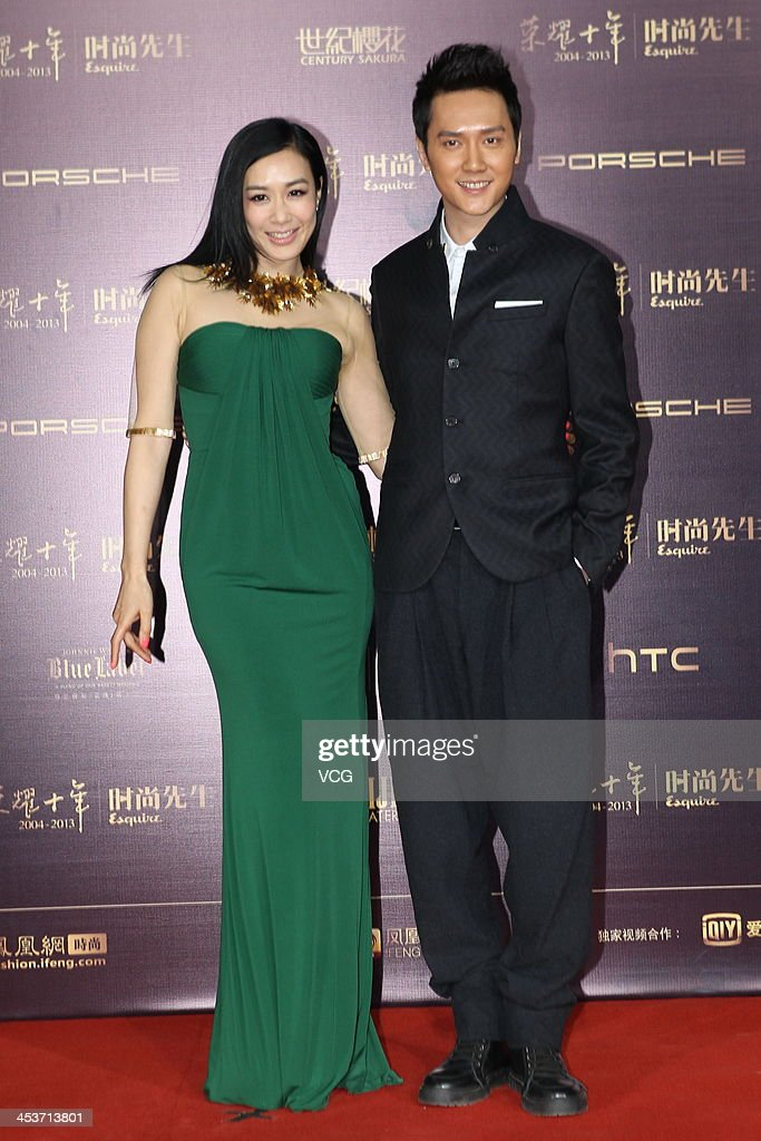 Actress Christy Chung£¨L) and actor Feng Shaofeng (R) attend Esquire Men Of The Year Awards 2013 at Oriental Theatre on December 4, 2013 in Beijing, China.