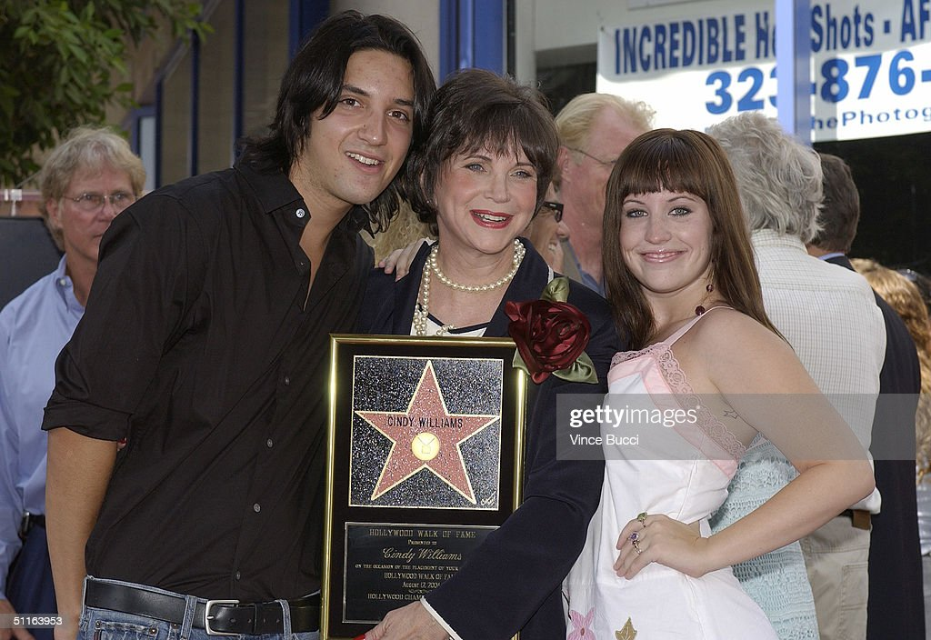 poses with her son zachary hudson and duaghter emily hudson