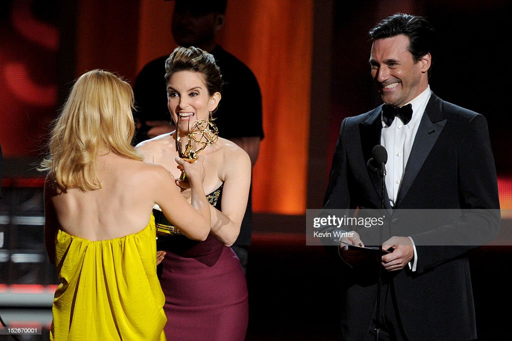 Actress <a gi-track='captionPersonalityLinkClicked' href=/galleries/search?phrase=Claire+Danes&family=editorial&specificpeople=202666 ng-click='$event.stopPropagation()'>Claire Danes</a> (L) accepts Outstanding Lead Actress in a Drama Series for 'Homeland' from actors <a gi-track='captionPersonalityLinkClicked' href=/galleries/search?phrase=Tina+Fey&family=editorial&specificpeople=206753 ng-click='$event.stopPropagation()'>Tina Fey</a> and <a gi-track='captionPersonalityLinkClicked' href=/galleries/search?phrase=Jon+Hamm&family=editorial&specificpeople=3027367 ng-click='$event.stopPropagation()'>Jon Hamm</a> onstage during the 64th Annual Primetime Emmy Awards at Nokia Theatre L.A. Live on September 23, 2012 in Los Angeles, California.