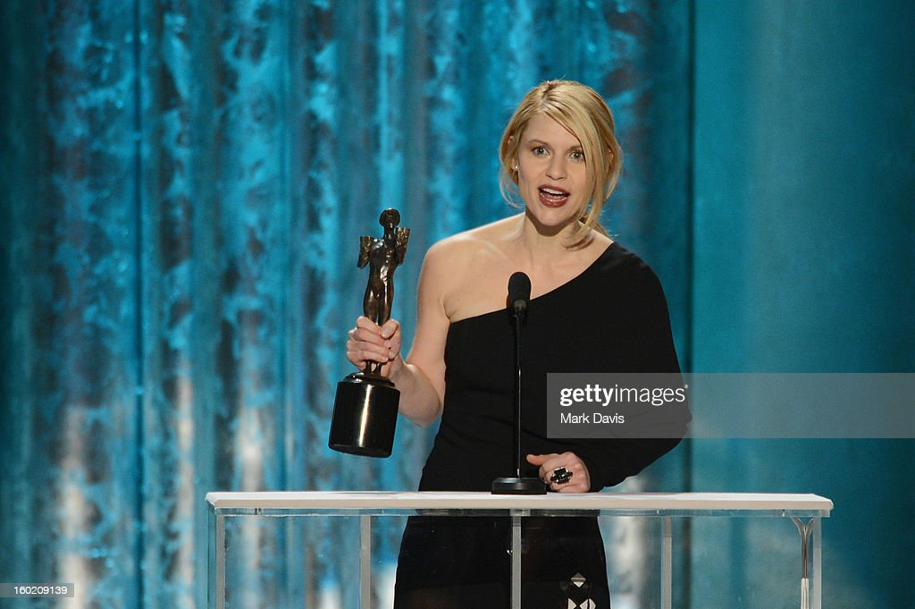 Actress <a gi-track='captionPersonalityLinkClicked' href=/galleries/search?phrase=Claire+Danes&family=editorial&specificpeople=202666 ng-click='$event.stopPropagation()'>Claire Danes</a> accepts the award for Outstanding Performance by a Female Actor in a Drama Series for 'Homeland' onstage during the 19th Annual Screen Actors Guild Awards held at The Shrine Auditorium on January 27, 2013 in Los Angeles, California.