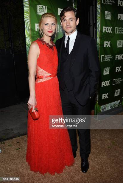 Actress Claire Danes and actor Hugh Dancy arrive at the FOX 20th Century FOX Television FX Networks and National Geographic Channel's 2014 Emmy Award...