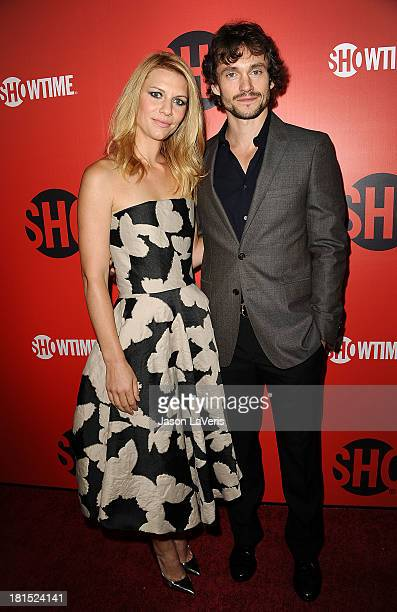 Actress Claire Danes and Hugh Dancy attend the Showtime Emmy eve soiree at Sunset Tower on September 21 2013 in West Hollywood California
