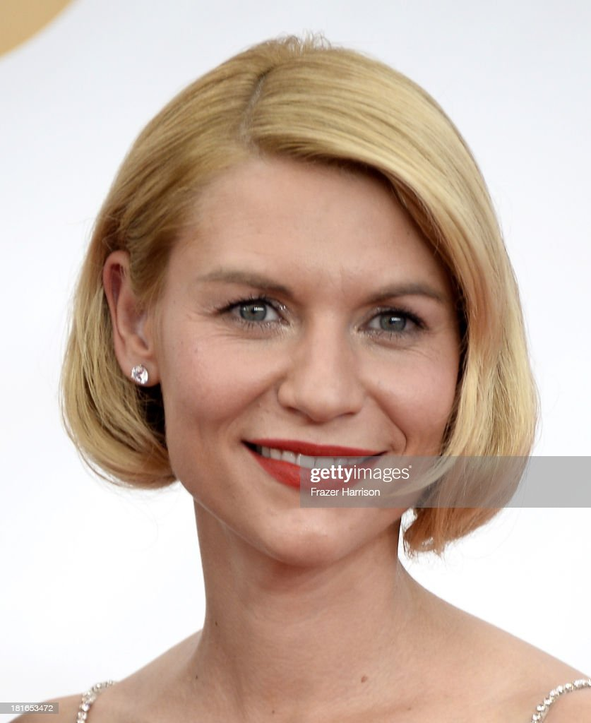 Actress <a gi-track='captionPersonalityLinkClicked' href=/galleries/search?phrase=Claire+Danes&family=editorial&specificpeople=202666 ng-click='$event.stopPropagation()'>Claire Danes</a> arrives at the 65th Annual Primetime Emmy Awards held at Nokia Theatre L.A. Live on September 22, 2013 in Los Angeles, California.