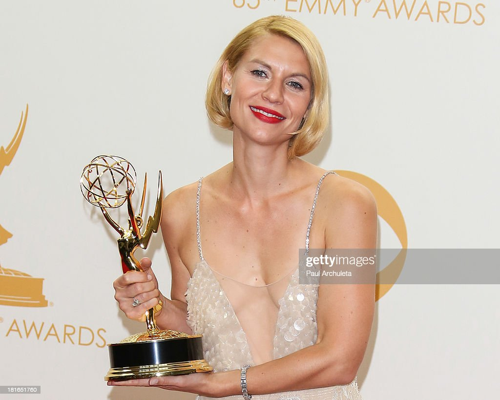 Actress <a gi-track='captionPersonalityLinkClicked' href=/galleries/search?phrase=Claire+Danes&family=editorial&specificpeople=202666 ng-click='$event.stopPropagation()'>Claire Danes</a> pose in the press room at the 65th annual Primetime Emmy Awards at Nokia Theatre L.A. Live on September 22, 2013 in Los Angeles, California.