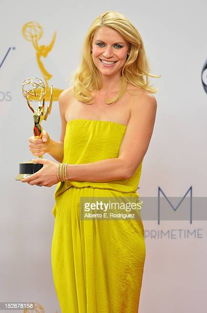Actress Claire Danes poses in the 64th Annual Emmy Awards press room at Nokia Theatre LA Live on September 23 2012 in Los Angeles California