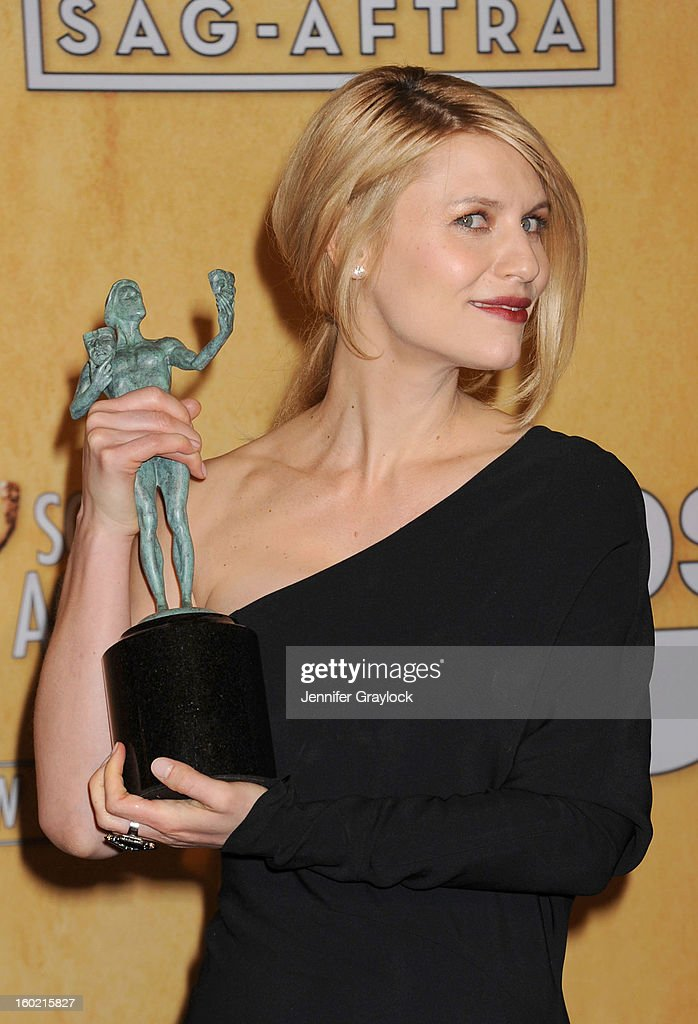 Actress <a gi-track='captionPersonalityLinkClicked' href=/galleries/search?phrase=Claire+Danes&family=editorial&specificpeople=202666 ng-click='$event.stopPropagation()'>Claire Danes</a> poses in the press room at the 19th Annual Screen Actors Guild Awards at The Shrine Auditorium on January 27, 2013 in Los Angeles, California.
