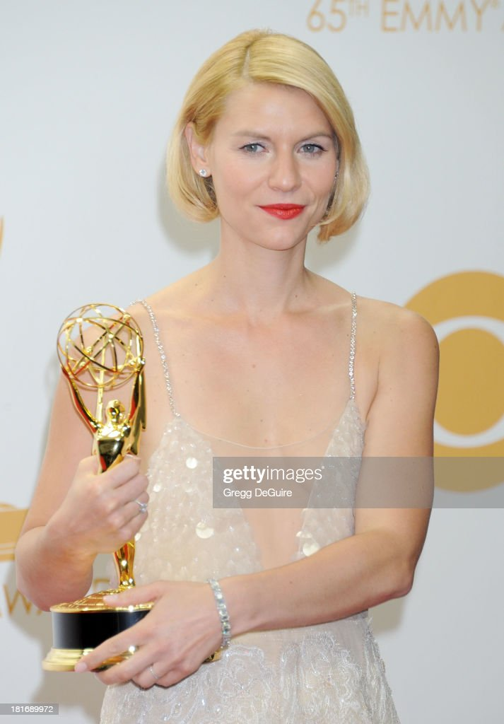 Actress <a gi-track='captionPersonalityLinkClicked' href=/galleries/search?phrase=Claire+Danes&family=editorial&specificpeople=202666 ng-click='$event.stopPropagation()'>Claire Danes</a> poses in the press room at the 65th Annual Primetime Emmy Awards at Nokia Theatre L.A. Live on September 22, 2013 in Los Angeles, California.