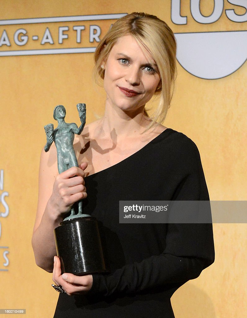 Actress <a gi-track='captionPersonalityLinkClicked' href=/galleries/search?phrase=Claire+Danes&family=editorial&specificpeople=202666 ng-click='$event.stopPropagation()'>Claire Danes</a> poses in the press room during the 19th Annual Screen Actors Guild Awards held at The Shrine Auditorium on January 27, 2013 in Los Angeles, California.