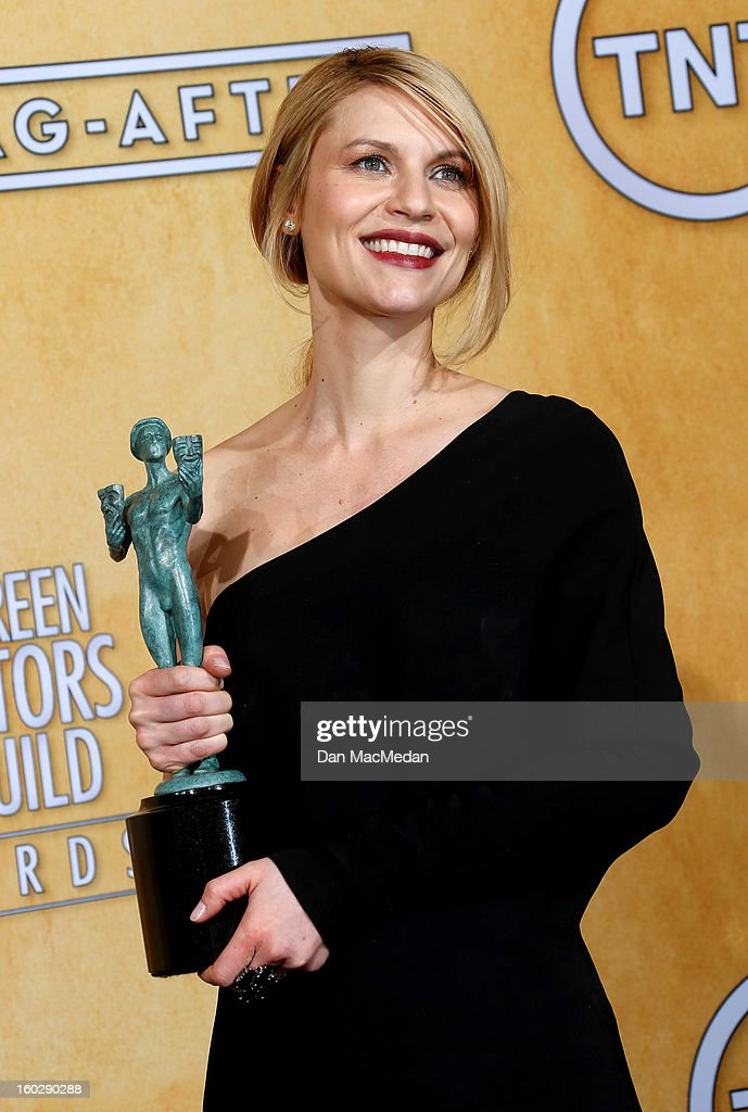 Actress <a gi-track='captionPersonalityLinkClicked' href=/galleries/search?phrase=Claire+Danes&family=editorial&specificpeople=202666 ng-click='$event.stopPropagation()'>Claire Danes</a>, winner of Outstanding Performance by a Female Actor in a Drama Series for 'Homeland,' poses in the press room at the 19th Annual Screen Actors Guild Awards at the Shrine Auditorium on January 27, 2013 in Los Angeles, California.