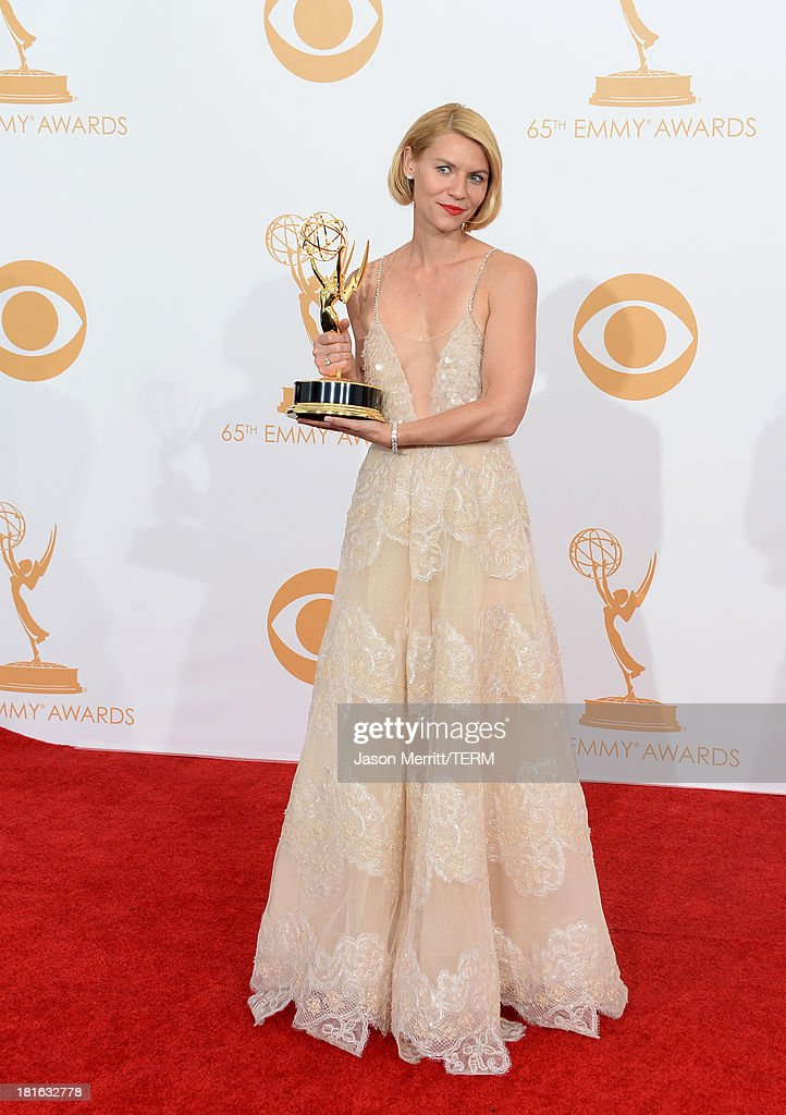 Actress Claire Danes winner of the Best Actress In a Drama Series for 'Homeland' poses in the press room during the 65th Annual Primetime Emmy Awards...