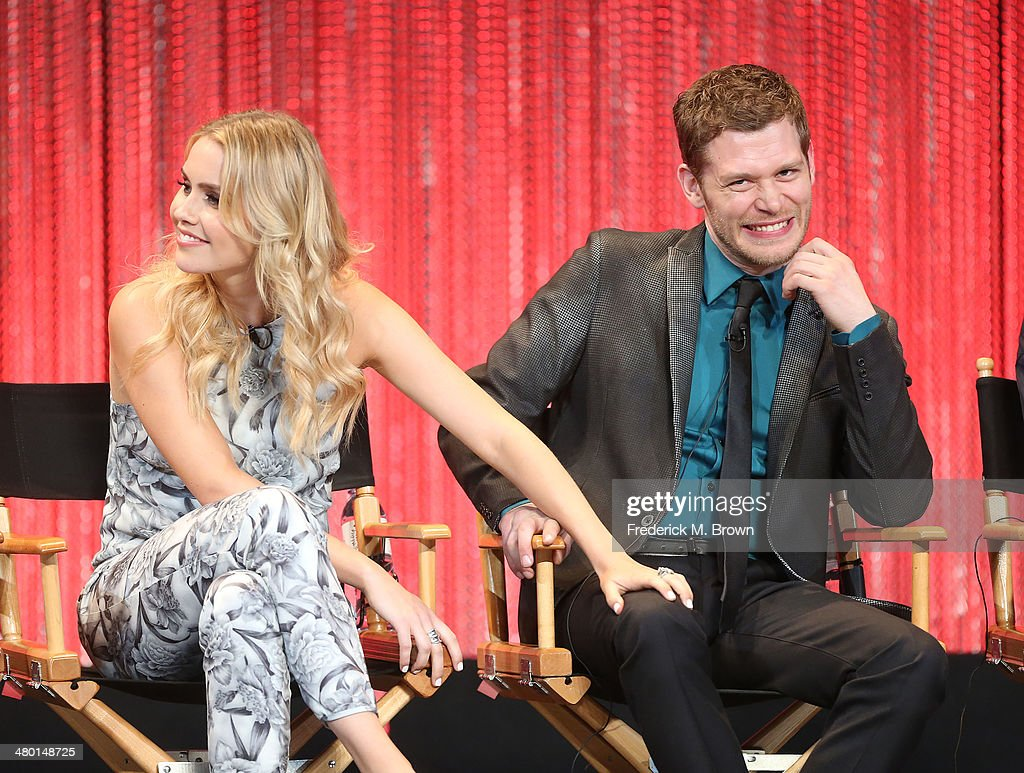 Actress <a gi-track='captionPersonalityLinkClicked' href=/galleries/search?phrase=Claire+Holt&family=editorial&specificpeople=5082295 ng-click='$event.stopPropagation()'>Claire Holt</a> (L) and actor Joseph Morgan speak The Paley Center for Media's PaleyFest 2014 Honoring 'The Vampire Diaries' and 'The Originals' at the Dolby Theatre on March 22, 2014 in Hollywood, California.