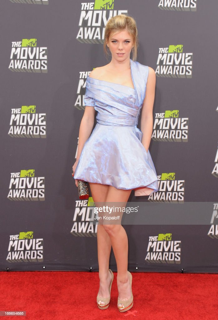Actress Claire Julien arrives at the 2013 MTV Movie Awards at Sony Pictures Studios on April 14, 2013 in Culver City, California.