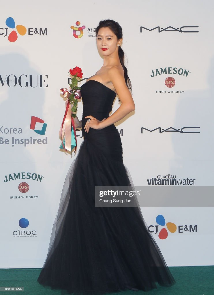 Actress <a gi-track='captionPersonalityLinkClicked' href=/galleries/search?phrase=Clara+-+South+Korean+Actress&family=editorial&specificpeople=13597668 ng-click='$event.stopPropagation()'>Clara</a> arrives for the APAN star road during the 18th Busan International Film Festival on October 4, 2013 in Busan, South Korea.